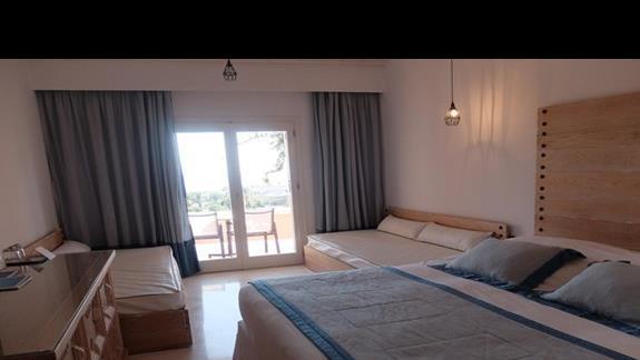 pokój standard z dostawkami w hotelu Mitsis Rodos Village