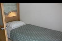 Hotel Mitsis Blue Domes Exclusive Resort & Spa - Drugie pomieszczenie w pokoju rodzinnym.