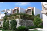 Hotel Mitsis Blue Domes Exclusive Resort & Spa - Bungalow w którym znajduja sie pokoje rodzinne.