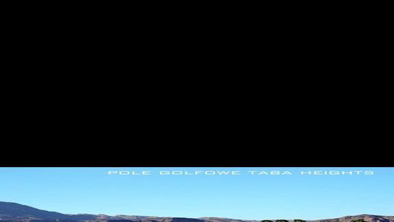 Pole golfowe w Taba Heights (czy w letnim słońcu też będzie zielone?)
