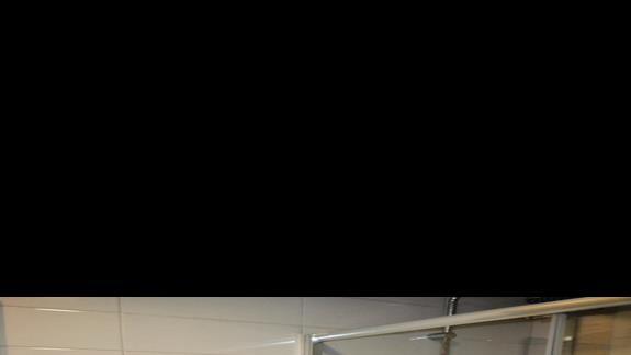 Łazienka w pokoju w hotelu Mermaid Village