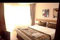 Hotel Ramada Resort Lara - sypialnia w pokoju rodzinnym w hotelu Ramada Resort Lara