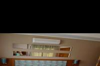Hotel River Garden - Apartament - sypialnia z lózkiem malzenskim