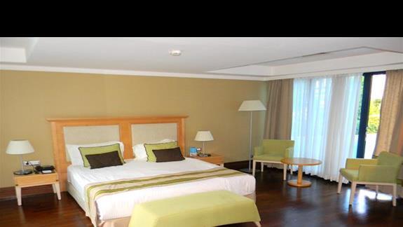Sypialnia w budynku Lake House w hotelu Susesi De Luxe Resort
