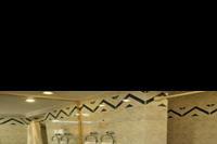 Hotel Desert Rose Resort - łazienka w p.standardowym w  hotelu Desert Rose