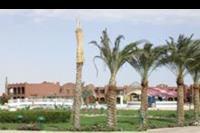 Hotel Rixos Premium Magawish - Pietrowe budynki hotelowe z basenem