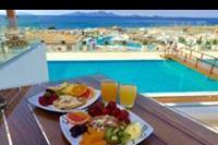 Hotel Mitsis Blue Domes Exclusive Resort & Spa - Śniadanie z widokiem na piękną panoramę Morza Egejskiego Exclusive Resort & Spa