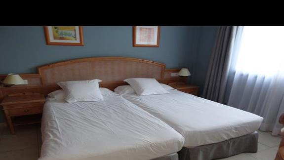 Sypialnia w pokoju ALoe Club